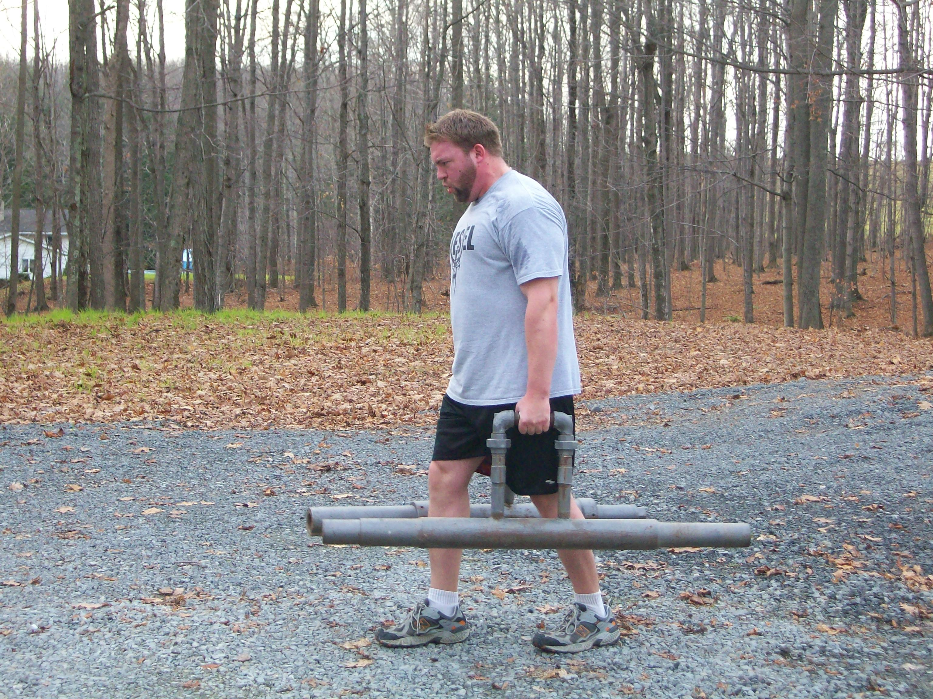 farmers implement homemade strongman exercise routine