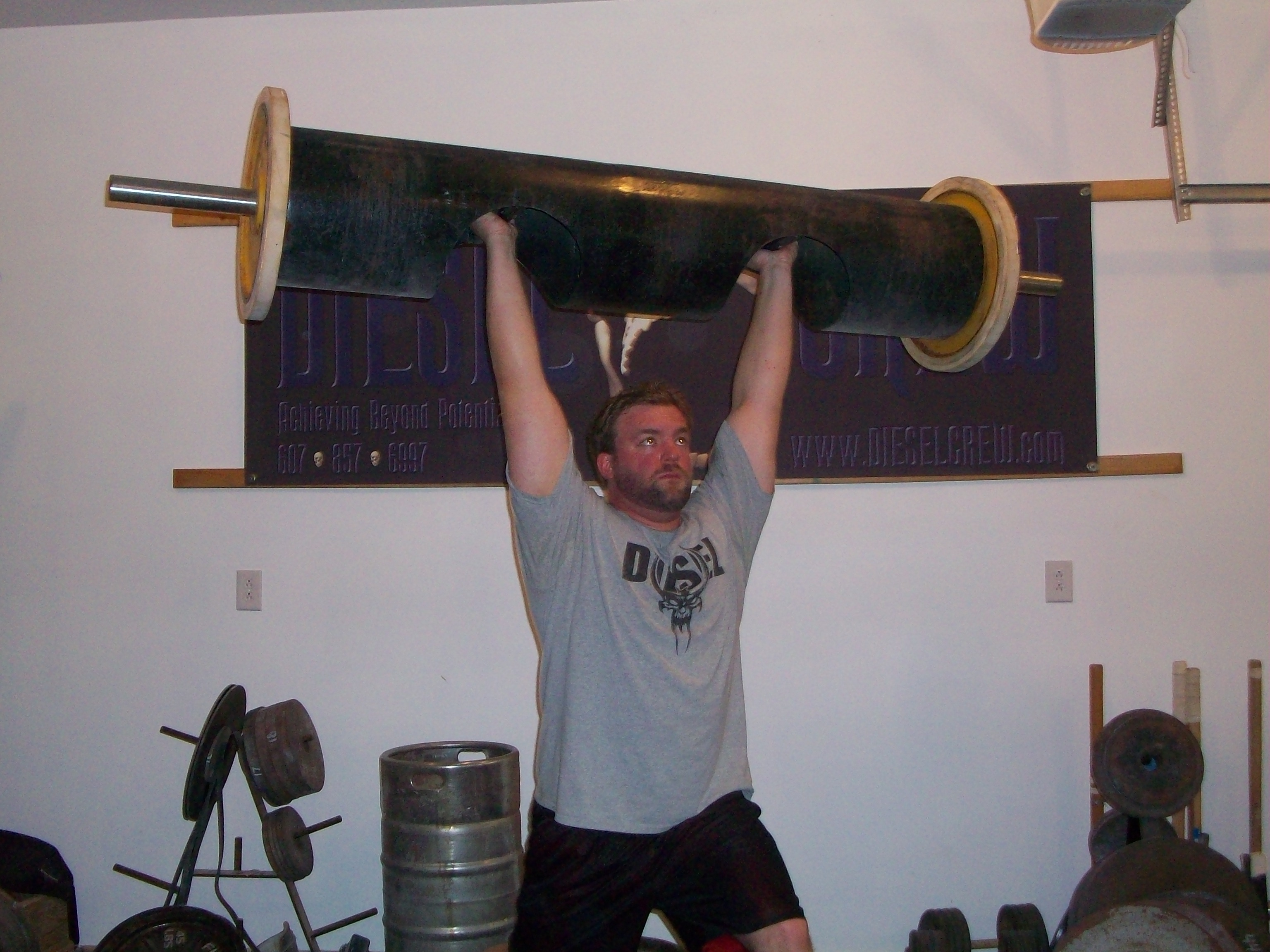 log overhead lift strongman exercises workouts