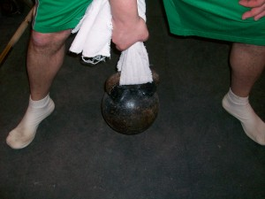 Towel Looped Around Kettlebell Handle