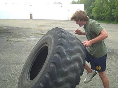 Sledgehammer Slams On A Tire