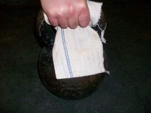 training grip with a towel on a kettlebell handle